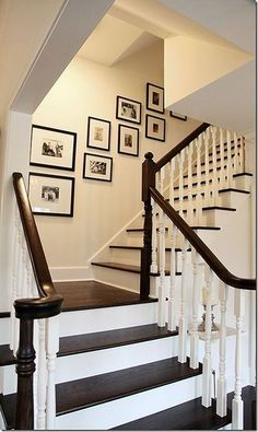 Love the contrast of dark wood versus white trim on these stairs...Our new stairs!