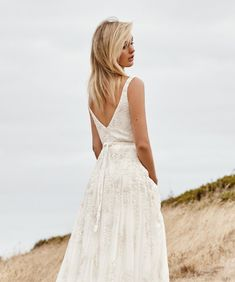 Beatrice is a sheath beaded wedding dress with a v-neck and open back and A-line skirt. Could Beatrice be 'the dress' for you? Try it on at a KWH boutique! Indie Wedding Dress, Wedding Dresses, Karen Willis Holmes, Sequin Gown, Fall Skirts, Bridal Boutique, Fitted Bodice, Tulle, Sequins