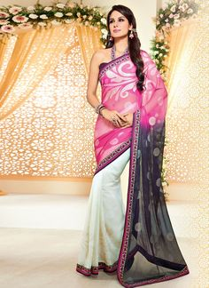 Give in to the exotic confluence of today and tomorrow in this beautiful attire. Spread the aura of freshness with this hot pink and off white faux chiffon and brasso designer saree showing a touch of...
