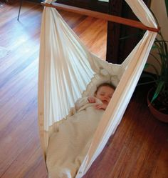 Natures Sway Organic Baby Hammock - the latest design incorporating a bed shape which gently supports the natural C-curve of baby's spine... most babies would be in it for 4-6 months before they could potentially wriggle out. Naturally resistant to mold, its water absorbency properties means it can hold moisture w/o feeling damp, keeping baby warm & dry... fabric is soft, durable & free from harmful chemicals... can be hung from ceiling, beam or door frame & can support weight of up to 33lb
