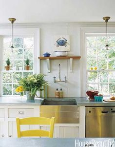 With modern amenities and vintage touches, this kitchen has old pendant light fixtures, no-fuss zinc countertops, and chairs rescued from a friend's basement and painted a sunshiny yellow. Design: Ruthie Sommers.