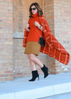 Anna of A Lily Love Affair styles our oversized orange plaid scarf with our bold sleeveless turtleneck and a camel skirt for a perfectly balanced fall outfit | Banana Republic