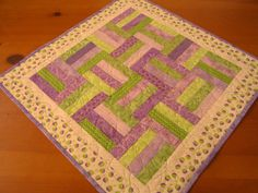 Quilted Table Topper Spring by PatchworkMountain on Etsy