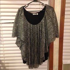 Size 18/20 Cato brand. Never worn Very pretty and shiny. Has built in black camisole. New without tags. Comes from smoke free home Cato Tops Blouses
