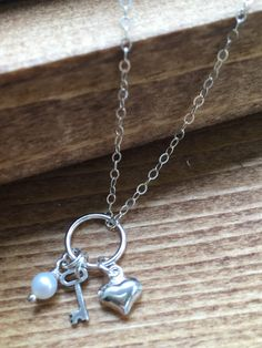 Charm Necklace, Layered Necklace, Heart and Key, Sterling Silver Jewelry, Sterling Necklace, Personalized Necklace, Custom Charm Necklace by SFDesigns2015 on Etsy https://www.etsy.com/listing/263729927/charm-necklace-layered-necklace-heart