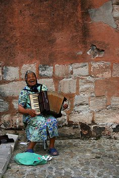 Old woman playing squeeze box at Avignon's Festival.  France
