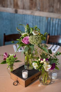 Whimsical purple, white and green centerpieces for a rustic glam wedding {Jennifer Weems Photography}