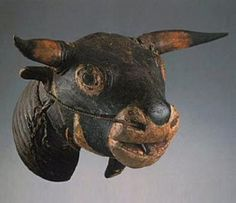 """Bidjogo peoples, Caduna, Ilha de Uno, Bissagos Islands, Guinea-Bissau Wood, horns, fiber cord, pigment, glass eyes Height 46 cm (19 1/8 inches)  The most spectacular Bidjogo mask is a helmet mask called Vaca Bruto (meaning """"wild cattle""""). The largest examples are found on the islands of Uno  and Formosa. The dancer gives the object its most realistic presence by bowing and facing the ground. Its eyes of frosted glass, real horns, leather ears  and the rope through the nostrils are all…"""