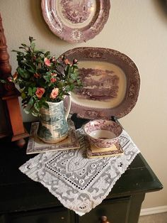 Victorian inspired display of mostly purple Staffordshire transferware.