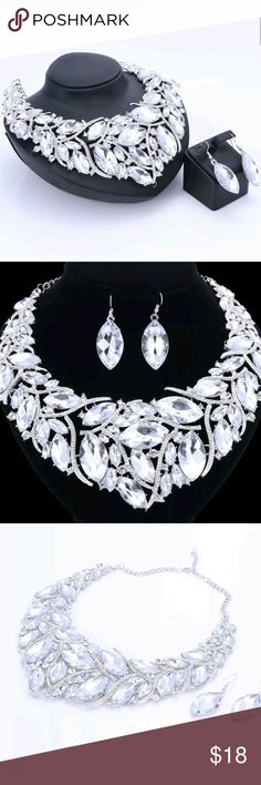 "AUSTRIAN CRYSTAL JEWELRY SET Set comes with necklace and earrings. Necklace is 9"" x 7"" measuring straight up and down through the middle and from side to side. Earring measure approximately 1"" long x 1/2"" wide. Silver plated Alloy based with Clear Crystals. Brand new. Jewelry Necklaces"