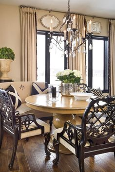love the silver trays over the windows, the monogrammed settee, colors and those chairs!!!