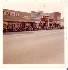 Bikers gathering for the Motorcycle Races, West side of the 900 block of Main Street, Winfield, KS - 1972. Photo by John Ozbun.