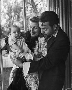 Orson Welles, wife Rita Hayworth and daughter Rebecca at home in 1945
