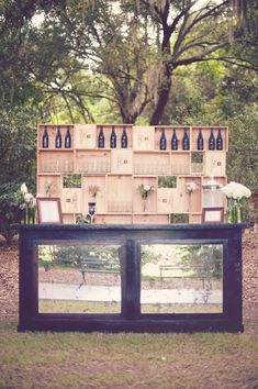 rustic outdoor wine bar http://www.weddingchicks.com/2013/09/27/pink-and-cream-wedding/