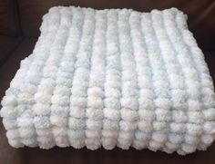 Hand knitted blue and white marshmallow baby blanket Katie Bees Baby Knits. Available on Etsy.