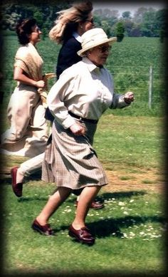 Queen Elizabeth II, breaks out into a jog at the 1998 Royal Windsor horse…