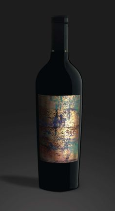 Waters Winery and Gramercy Cellars requested that  Boxwood assume the package design for their joint label, 21 grams, in 2012. Each year artist Makoto Fugimura creates a new piece of artwork for this brand. It was Boxwood's task to determine a printing method to properly recreate the paint and gold leaf work in miniature on a bottle. This year's label was printed four color on gold foil with matte and gloss varnishes. #21grams #wine #Washington #art #Fugimura #WallaWalla