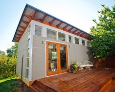 mahogany wood garage grey house   Awesome Modern Garage And Shed For Luxury Prefab Homes With Gray ...