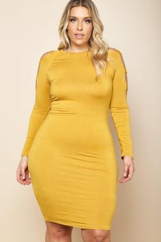 A plus size mini dress with a round neckline. Features long sleeves with cutouts. Solid colored all over.