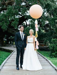 giant balloon tassel + fringe wedding shot by Brooke Images
