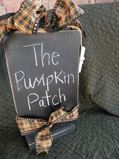 DIY Chalkboard Sign which would be easy to change the ribbon for a different season or holiday along with written message. From Seasons Of Joy: Halloween Decor: The Pumpkin Patch