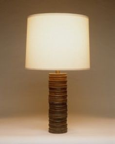 Primitive Occasional Table Lamp: - Rings of cold cast bronze are stacked together under a beige linen shade. These lamps bring an element texture and earthiness to any room. Primitive, Bronze, Shades, Lights, Table Lamps, Interior, Floor Lamps, Collection, Plymouth