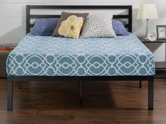 A metal platform bed elevated enough for you to store things underneath. Metal Platform Bed, Comforters, New Homes, Blanket, Stylish, Interior, Kids, House, Furniture