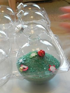 acrylic ornaments, fill with colored epsom salt (food coloring) and little items to find...how cute!
