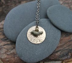 """This necklace is inspired by the stanza from Emily Dickinson's poem """"Hope"""": Hope is the thing with feathers,  That perches in the soul,  And sings the tune--without the words,  And never stops at all... :: hope . a so i fly hand stamped soul mantra bird necklace"""