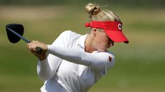 Brooke M. Henderson, of Canada hits a shot on the range before a practice round for the women's golf event at the 2016 Summer Olympics in Rio de Janeiro, Brazil, Monday, Aug. 15, 2016. (AP Photo/Alastair GrantRio 2016: Brooke Henderson, women's golf