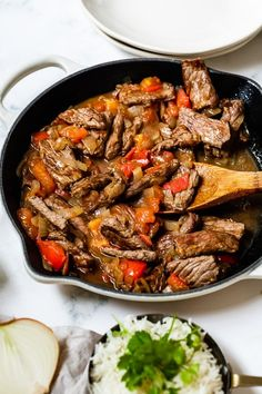 Beef lovers, you'll love this quick Colombian Carne en Bistec steak dish cooked with onions, tomatoes and cumin. The onions and tomatoes create a flavorful sauce which is wonderful served over rice. #carnebistec #colombianrecipes #steak Mexican Food Recipes, Beef Recipes, Dinner Recipes, Cooking Recipes, Healthy Recipes, Ethnic Recipes, Recipies, Dinner Ideas, Weekly Recipes