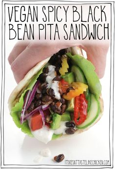 This 20-minute vegan pita is next-level delicious! With spicy black beans, a creamy tangy mayo, and a mountain of fresh veg, this is the perfect hearty vegan sandwich the enjoy for lunch or dinner. These sandwiches can be made oil-free, gluten-free, and if you don't have any pitas on hand, feel free to load all of these toppings into a wrap or on your favourite sandwich bread. #itdoesnttastelikechicken #veganrecipes