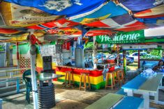 Interior shot of Lion Rock Beach Bar in St. Kitts, my favorite beach bar in the world. I bounce back and forth between Lion Rock and Shipwreck Beach Bar in … Beach Cafe, Two And A Half, Filming Locations, West Indies, St Kitts And Nevis, Things That Bounce, Caribbean, Tours, Bar