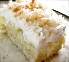 Coconut cream pie cookie squares! Sugar cookie crust, coconut pie filling, homemade whipped cream topping YUMMY!