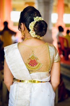 Traditional Southern Indian bride wearing bridal silk saree and pretty lace blouse. Love the hair bun. Netted Blouse Designs, Wedding Saree Blouse Designs, Blouse Neck Designs, Saree Wedding, Blouse Styles, Indian Bridal Hairstyles, Bun Hairstyles, Simple Hairstyles, Blouse Designs Catalogue