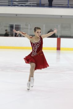 Red ice dance dress with gold and blue rhinestones by Joanie's Skating Boutique