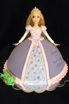 barbie doll birthday cake | Rapunzel Doll Birthday Cake - I'm normally not a fan of doll cakes and slightly cringe any time someone asks me about one, but this one was done so well and so cute!!!!  Love the little Pascal!  Adorbs!