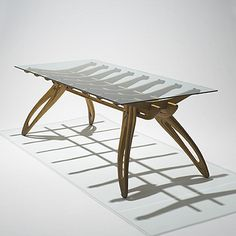 Lot 594: Franco Campo and Carlo Graffi. dining table. c. 1955, acero, glass, brass. 83¾ w x 36 d x 29¼ h in. result: $216,000. estimate: $100,000–150,000. This table exemplifies the style that Campo and Graffi developed beginning in the 1950s. The skeletal frame atop perched legs expresses the anthropomorphic tendency that characterizes their work.