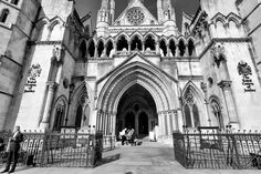 The Royal Courts of Justice, commonly called the Law Courts, is a court building in London which houses the High Court and Court of Appeal of England and Wales. #London #mkhardy #Street #Photography #blackandwhite #monochrome