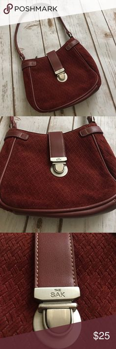 """The Sak -  Burgundy Body 100% Leather Purse The Sak -  Burgundy 100% Leather Body Purse, gorgeous in like new condition. About 9"""" across, and 6.5"""" up/down or 15"""" Up/down from handle to bottom of bag. Please be sure to check out all of my other boutique items to bundle and save. Same day or next business day shipping is guaranteed. Reasonable offers will be considered! The Sak Bags"""
