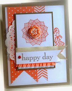 Me, My Stamps and I: Consider It Cased Stamps:  Happy Day Paper:  Crisp Cantaloupe, Crumb Cake, Whisper White, In Color DSP Ink:  Crisp Cantaloupe, Crumb Cake Accessories:  cotton ribbon, ruffled stretch ribbon, brad, clay blossom Tools:  dimensionals, clay molds