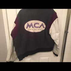 MCA RECORDS Logo Baseball Jacket circa 1994 MCA RECORDS Logo Baseball Jacket circa 1994 - Vintage.  From the NYC office of MCA Records where I worked.  Heavy jacket, great for cold weather.  Great Condition.  (Spots are on mirror not on item).  Small that runs big.  Might be a small men's jacket size. Identity Inc. Jackets & Coats