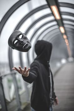 I really enjoy this photo especially how the shutter speed was able to get the image of the mask falling and how they got it to face the camera. but I don't like the fact the actual man is blurred into the background Dark Photography, Creative Photography, Portrait Photography, Artistic Photography, Photography Tricks, Monochrome Photography, Nikon Photography, Photo Hacks, Foto Portrait