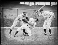 1935  -New York Yankee Ben Chapman, Boston Red Sox Al Schacht and Billy Werber. Baseball clown Al Schacht appears to be stealing a base.