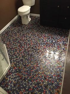 q beer cap bathroom floor, bathroom ideas, flooring Beer Cap Bathroom Floor I wanted something different and unique in my basement bathroom. I started saving caps through bars and friends and here are the results!