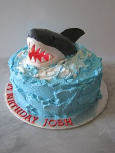 (Jack liked this one the best also, but I convinced him to switch to the cupcakes!) . . . Shark Cake for Jack - I like this one for simplicity. Need to figure out how to do the shark. Most of the pins I'm finding say that they make it out of RKT (which I now have discovered stands for Rice Krispy Treats) - would certainly be easier to mold, frost, etc. than cake. We'll see. Some say cut up marshmallows for the teeth, but I'm thinking molded white chocolate will produce the look I want . . .