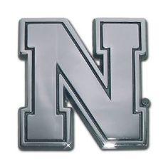 University of Nebraska Logo Silver Chrome Auto Emblem is for the University of Nebraska or NCAA, Nebraska Huskers sports fan made of solid chrome with a large single letter University of Nebraska text logo.