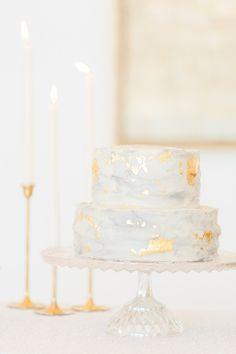 wedding cake with gold foil - photo by Cotton Weddings http://ruffledblog.com/modern-romantic-holiday-shoot