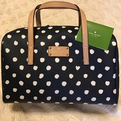 KATE SPADE POLKA DOT SATCHEL EUC Kate Spade. Used only few times. Auth card. No dust bag. Photos of actual purse.....except pic 3 (stock photos for full view of style of purse). See extra pics in my closet for handle condition and pic of dims and photo of purse being held (another bag but same size). kate spade Bags