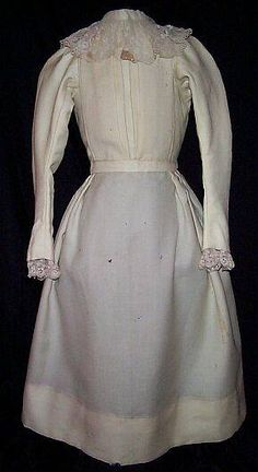 young girl's dress 1890s | 1897. A young girl's one piece dress made of creme colored wool ...